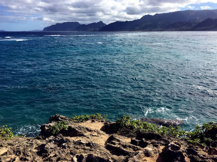 The edge of the cliff before the Pacific Ocean. Cliffs Hawaii Oahu Beauty In Nature Cliff Cliffside Cloud - Sky Day Idyllic Laie Land Nature No People Outdoors Rock Scenics - Nature Sea Sky Tranquil Scene Tranquility Water