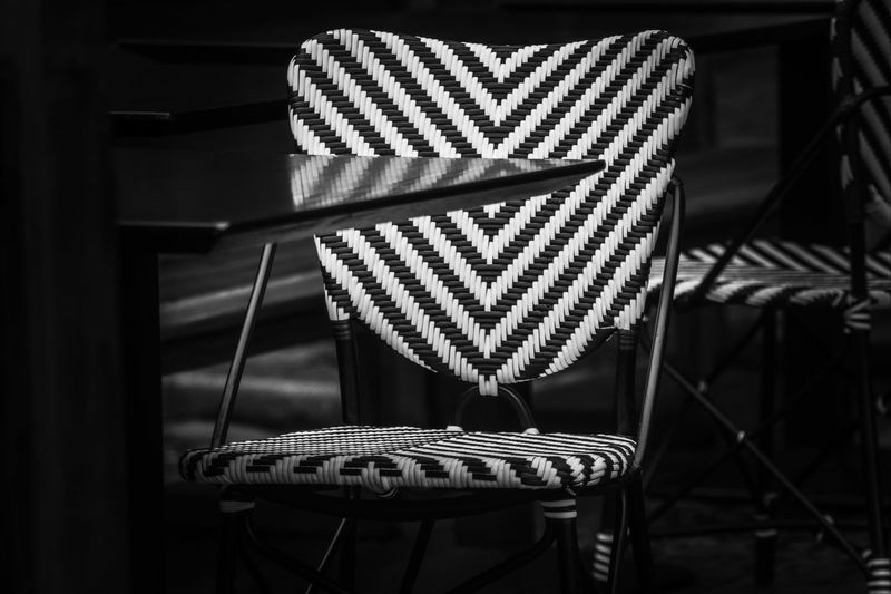 Close-up of empty chair by table