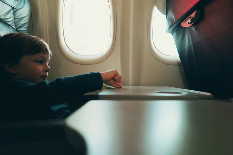 Boy sitting in airplane