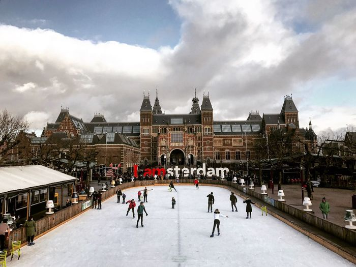 EyeEm Selects Built Structure Architecture Building Exterior Cloud - Sky Winter Sky Leisure Activity Weather Lifestyles Ice Rink Cold Temperature Travel Destinations Outdoors Ice-skating City Amsterdam Enjoying Life Travel EyeEm Selects Been There. Done That.