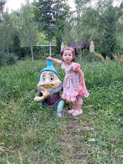 Girl wearing mask on field