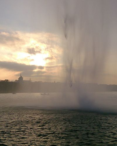 Sunset water feature Sunset Water Cloud - Sky Geneva Jetdeau Rain Lake Cityscape