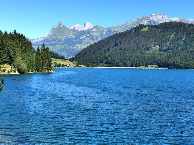 Mountain Tranquil Scene Scenics Water Blue Tranquility Waterfront Beauty In Nature Tree Lake Idyllic Clear Sky Nature Calm Mountain Range Holidays EyeEm Gallery Live For The Story Your Ticket To Europe