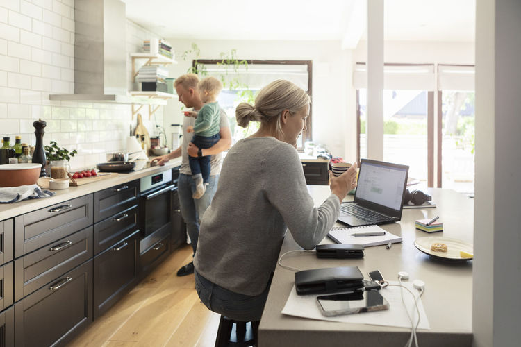 Women standing in kitchen at home