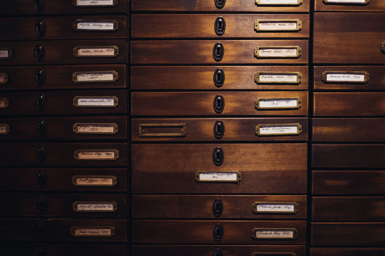 Drawer Indoors  Order No People Filing Cabinet In A Row Book Wood - Material Repetition Backgrounds Stack Old Safety Organization Full Frame Brown Furniture Arrangement Metal Close-up Cabinet File Cabinet