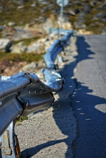 Ilulissat, Greenland, July | midnight sun | impressions of Jakobshavn | destroyed guard rail Shadow Sunlight Day Nature Focus On Foreground Selective Focus Outdoors Low Section Transportation City Road Demolished Destroyed Way Safety Vandalism Crash Barrier Road Safety Guardrail Crash