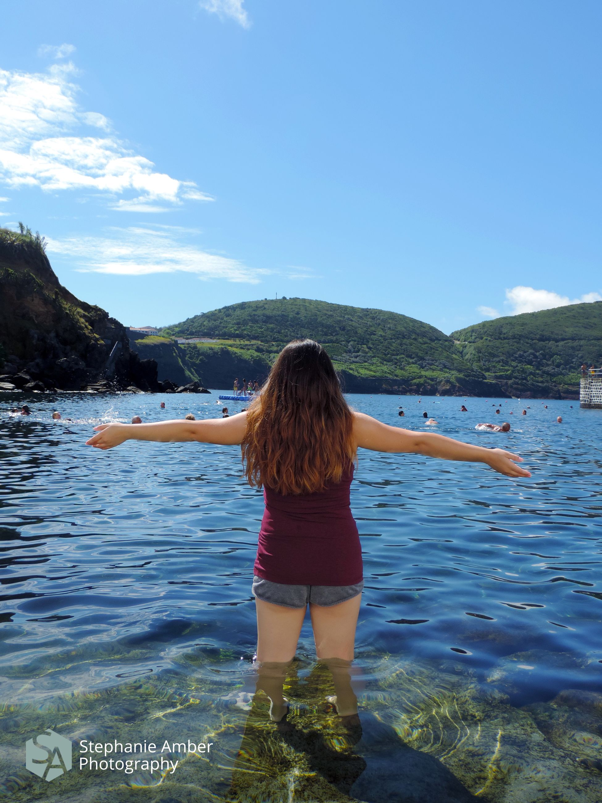 water, one person, rear view, leisure activity, real people, mountain, human arm, lifestyles, sky, beauty in nature, scenics - nature, women, hairstyle, limb, nature, vacations, trip, long hair, hair, arms outstretched, outdoors, arms raised