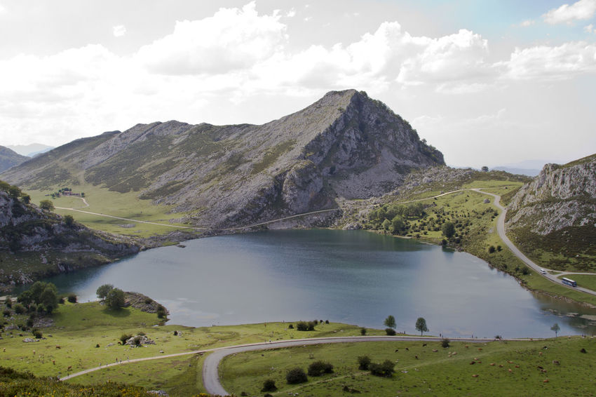 Lago Enol Picos De Europa Beauty In Nature Cloud - Sky Day Environment Idyllic Lago Enol Lake Landscape Mountain Mountain Range Nature No People Non-urban Scene Outdoors Road Scenics - Nature Sky Tranquil Scene Tranquility Transportation Volcanic Crater Water