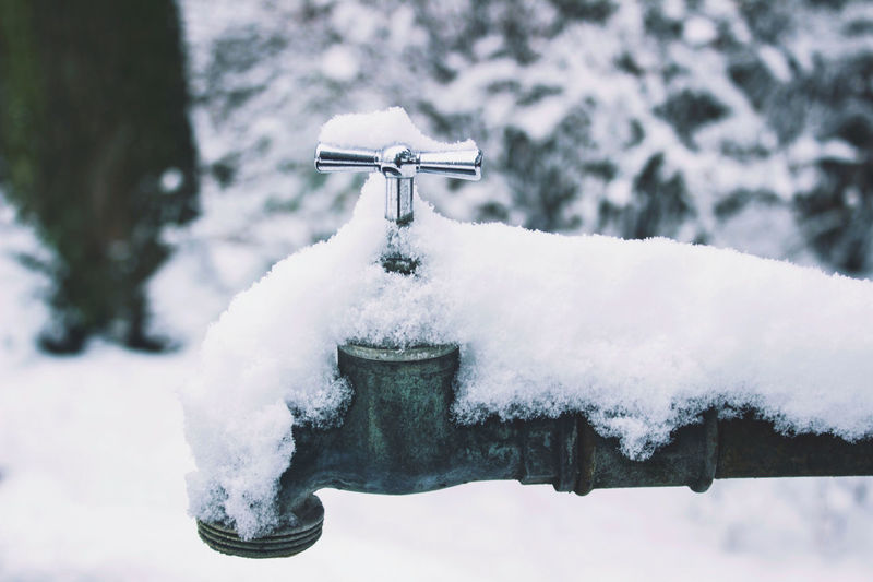Close-up of snowed tap