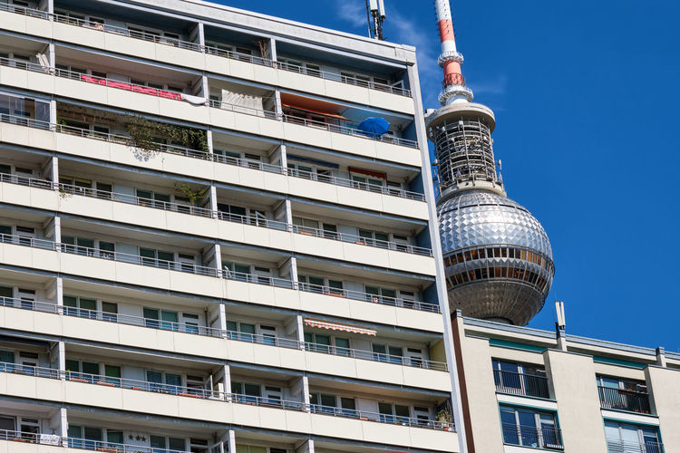 Subsidized housing building with the tv tower of berlin in the background