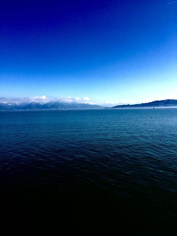 Beauty In Nature Blue Calm Day Idyllic Lake Of Constance Germany Majestic Mountain Nature No People Non Urban Scene Non-urban Scene Ocean Outdoors Remote Rippled Scenics Sea Seascape Sky Tranquil Scene Tranquility Wasserburg Am Bodensee Water