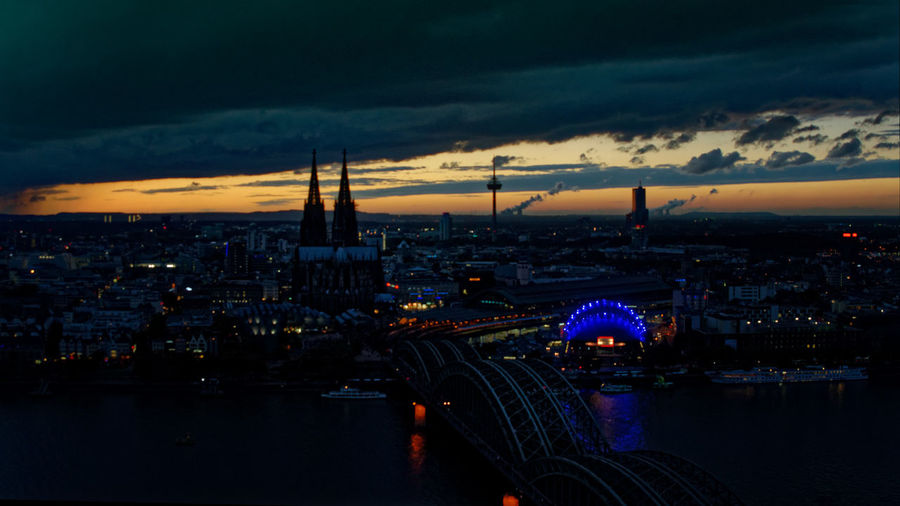 Der Abend bricht an Architecture Bridge Bridge - Man Made Structure Building Exterior Built Structure City Cityscape Cloud - Sky Connection Dusk Illuminated Nature Night No People Outdoors River Sky Sunset Transportation Travel Destinations Water HUAWEI Photo Award: After Dark