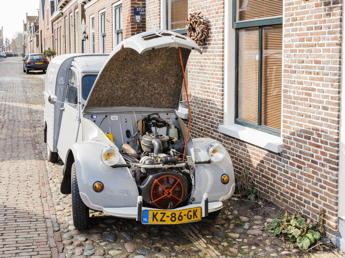 Vintage car Citroen 2CV AK400 with open hood in Hindeloopen, Netherlands. Citroën 2CV AK400 Citroen Citroen 2cv Vintage Cars Classic Car Collector's Car Delivery Van Delivery Van Hood Open Old Vintage Old-fashioned Nostalgia Memories French Retro Parking Cobblestone Old Town Netherlands Village Hindeloopen Front View Mode Of Transportation Transportation Architecture Building Exterior Land Vehicle Brick Wall Brick Motor Vehicle Day Car Built Structure City Retro Styled No People Wall Outdoors Street Building Stationary