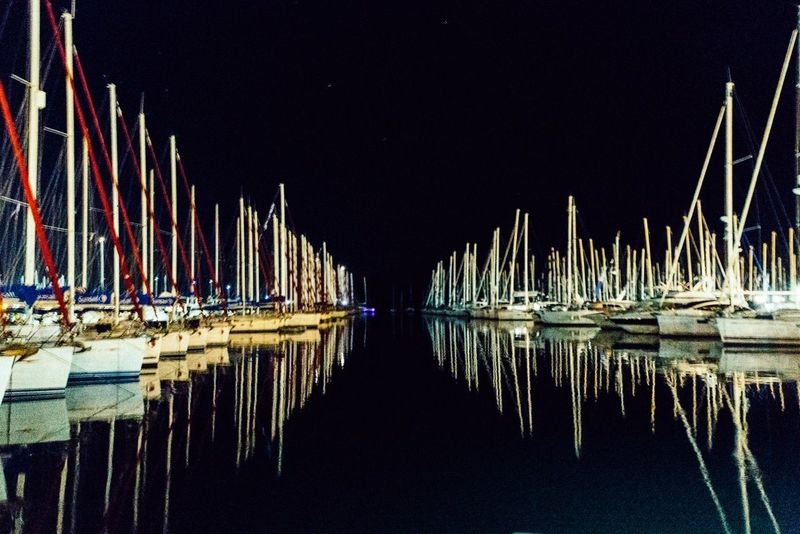 The Color Of Sport Sailing Ship In A Row Reflection Moored Sailboat Tranquil Scene Standing Water Tranquility Transportation Water Boat Nautical Vessel Nautical Vessel Moored Water Transportation Reflection Boat Mode Of Transport Mast In A Row Night Waterfront Calm