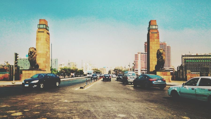 Car Architecture Transportation City Day Travel Destinations Outdoors Sky Skyscraper Building Exterior No People Egyptdailylife Scenics This Is Egypt ❤ Tranquility Built Structure Industry Freshness Tree Modern Cityscape Clear Sky Sculpture Urban Skyline Monument
