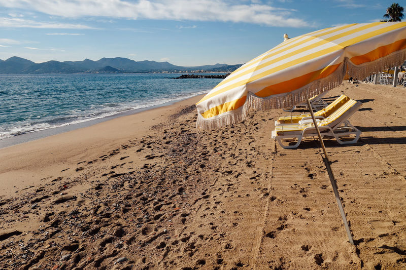 Beach Beauty In Nature Day Hills Horizon Over Water Hot Luxury Moutains Nature No People Outdoors Relaxation Sand Sea Sky Summer Sunlight Tourism Travel Destinations Umbrella Vacations Water Live For The Story