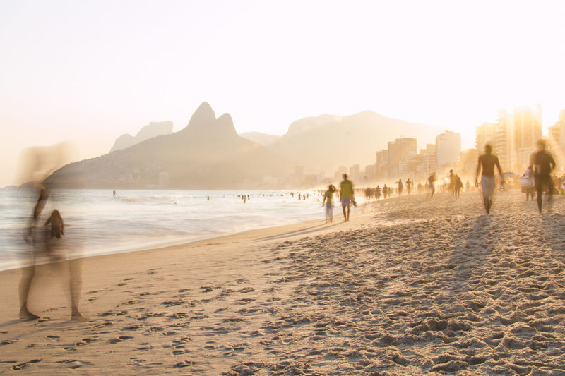 À la plage | Ipanema Beach capturing motion beach Enjoyment Group Of People Ipanema Leisure Activity Motion Blur Mountain Outdoors Scenics Slow Shutter Sunset Unrecognizable Person Color Palette The Great Outdoors - 2017 EyeEm Awards The Street Photographer - 2017 EyeEm Awards