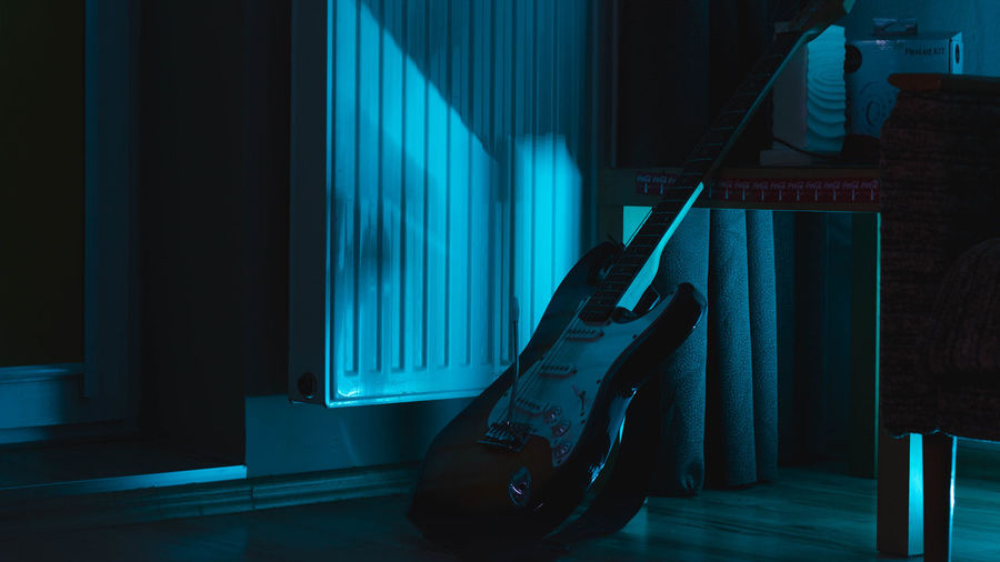 Moody nights Musical Instrument Illuminated Electric Guitar Arts Culture And Entertainment Performance Stage - Performance Space Curtain Singer  Rock Music Modern Rock Rock Musician Stage Light Bass Guitar Guitarist Musical Equipment Rock Group Recording Studio
