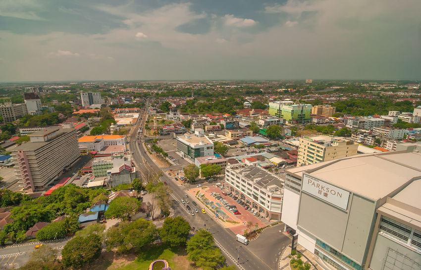 KEDAH, Malaysia - 23rd February 2018 : Downtown aerial view of Alor Setar town from top of 'Menara Alor Setar' tallest communication tower in world during sunny day. (motion soft focus noise grain) DarulAmanLand Aerial View Alor Setar Architecture Beauty In Nature Building Exterior Built Structure City Cityscape Cloud - Sky Communication Day Goverment Building High Angle View Hotel Kedah Nature Outdoors Parkson Road Scenics Sky Tower Tree Water