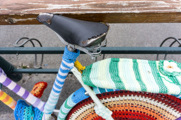 Close-Up Of Bicycle Designed With Multi Colored Wool