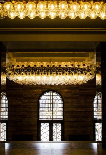 Illuminated entrance of historic building