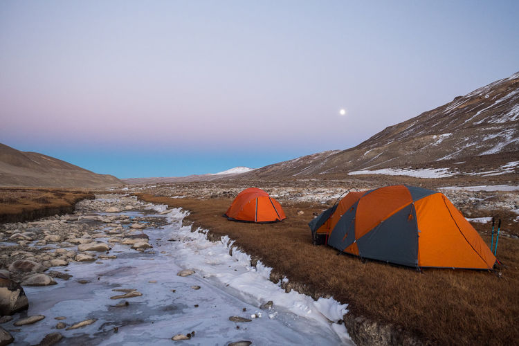 Beauty In Nature Mountain Sky Scenics - Nature Snow Tent Nature Cold Temperature Winter Tranquility Tranquil Scene Camping Environment Remote Mountain Range Non-urban Scene Adventure Landscape Idyllic No People Outdoors Snowcapped Mountain