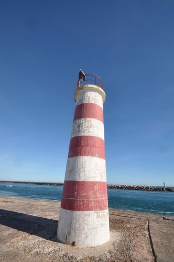 Light house Safety Sea Water Guidance Lighthouse Day Blue Clear Sky Outdoors No People Horizon Over Water Sky