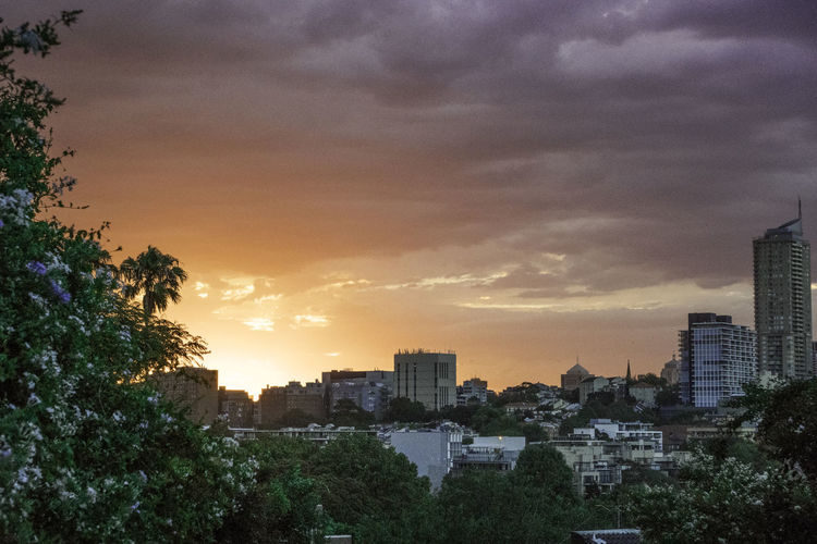 Panoramic view of cityscape against dramatic sky