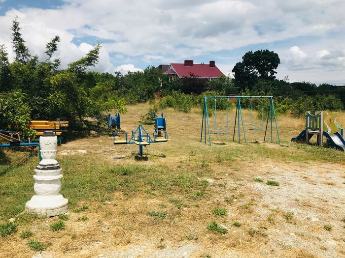 Playground Plant Sky Tree Cloud - Sky Nature Day Playground Land Childhood Jungle Gym Sunlight Park - Man Made Space Outdoors Park Sport Absence Built Structure Architecture Grass Field