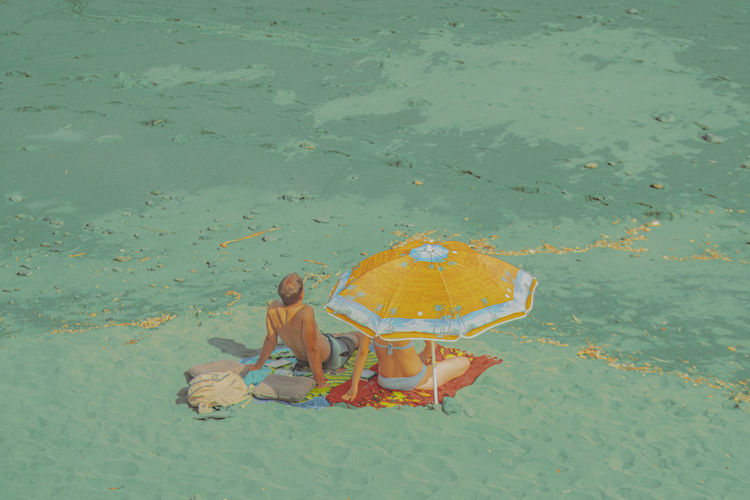 High angle view of yellow floating on sea shore