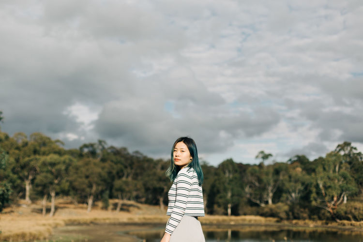 One Person Cloud - Sky Sky Nature Standing Plant Real People Young Adult Land Young Women Casual Clothing Leisure Activity Striped Tree Lifestyles Day Women Three Quarter Length Outdoors Hairstyle People Portrait Travel The Traveler - 2019 EyeEm Awards