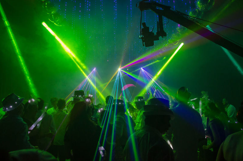 Green Light Beams Falling On People In Nightclub