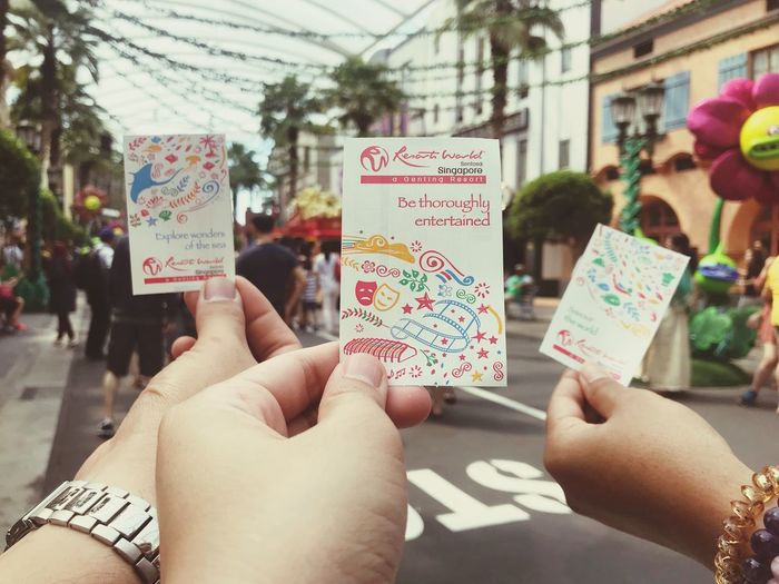 Have fun! Themeparks Amusement Park Card Ticket Universal Studios Singapore Human Hand Hand Real People Human Body Part Personal Perspective Text Holding Finger