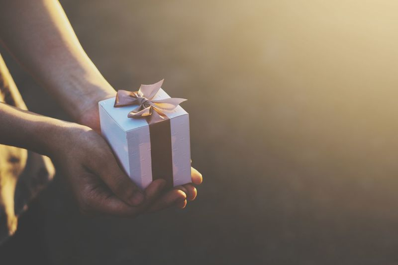 Close-up of woman holding gift box