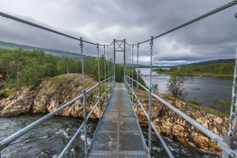 Water Nature Sky Day Connection Scenics Beauty In Nature No People Outdoors Growth Cloud - Sky Tree The Way Forward Tranquility Footbridge Tranquil Scene Mountain Hiking Abisko Fjallravenclassic Lappland Sweden