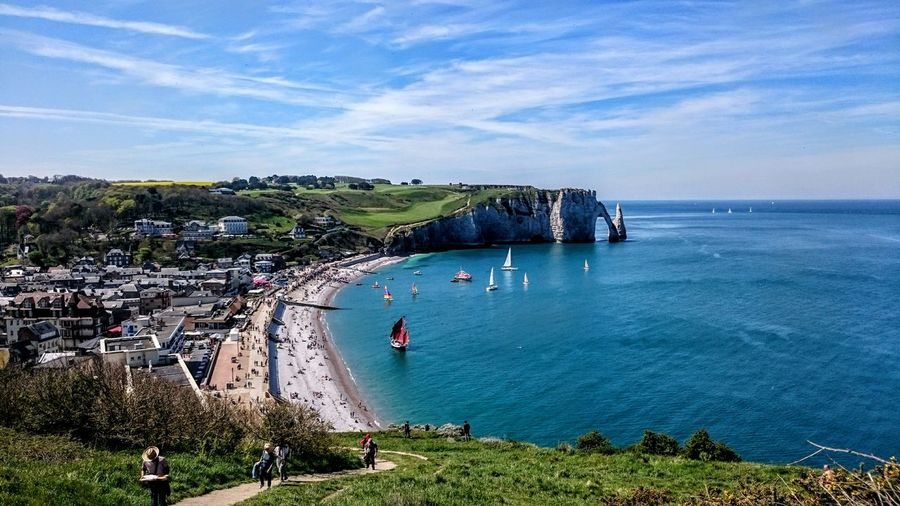 Scenic view of sea and city against sky at etretat