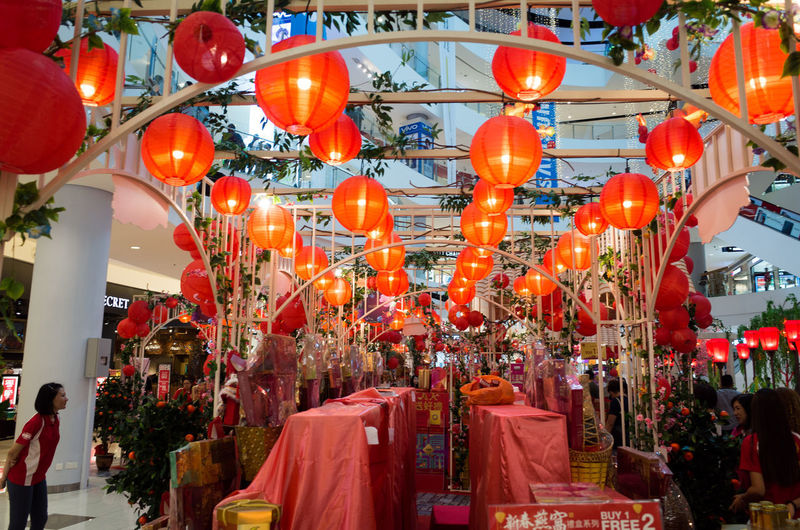 Hanging Lighting Equipment Lantern Decoration Red Chinese Lantern Retail  Incidental People Architecture Illuminated Market Real People Shopping Large Group Of Objects Celebration Group Of People Built Structure Outdoors Paper Lantern Chinese New Year