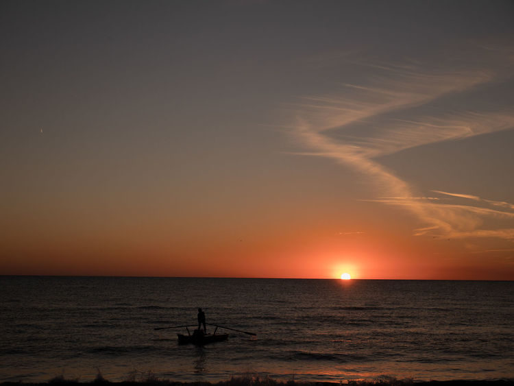 Colours Nature Quiet Beach Beauty In Nature Colours Of Nature Horizon Horizon Over Water Idyllic Nature No People One Person Orange Color Outdoors Real People Scenics - Nature Sea Ship Silhouette Sky Sun Sunset Tranquil Scene Tranquility Water
