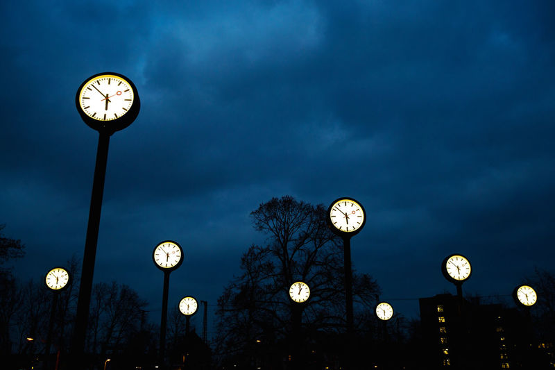 Illuminated Clock Sky Lighting Equipment Night Low Angle View Time Dusk Cloud - Sky No People Architecture Tree Nature City Outdoors Plant Moon Clock Face Light Minute Hand Clocks Many Clocks Nightsky Stress Deadline Pole Circles Timeline Uhrenpark Illuminated Clock Round Clocks Shine Bright Threatening