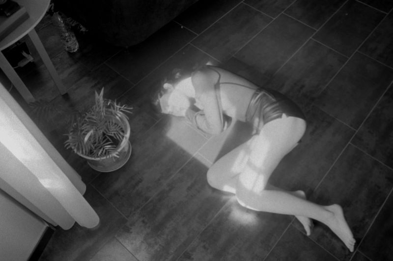 High angle view of woman relaxing on floor at home
