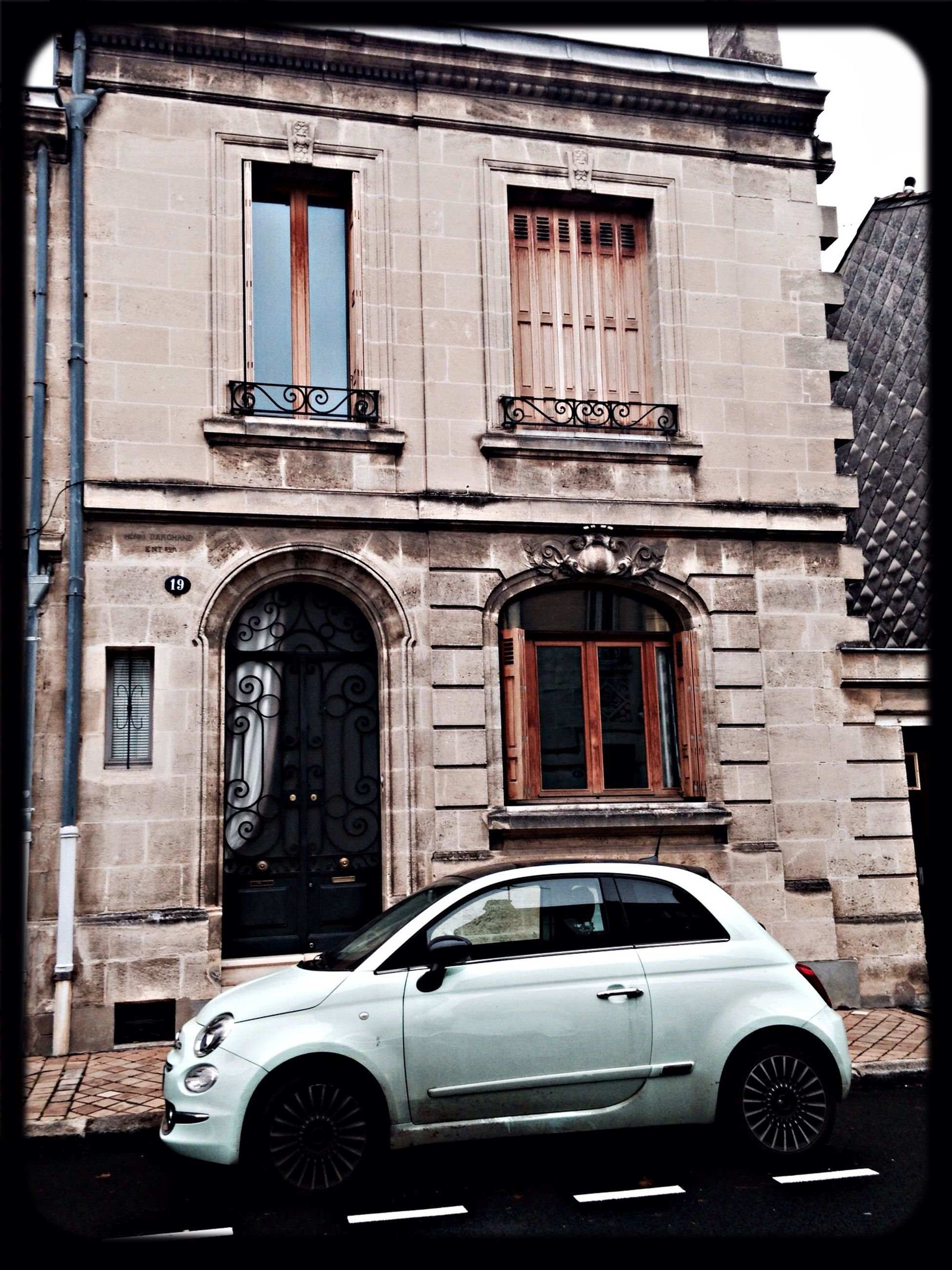 building exterior, built structure, architecture, transportation, window, car, land vehicle, mode of transport, no people, city, outdoors, day