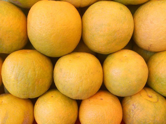 Full frame shot of sweet limes for sale at market stall