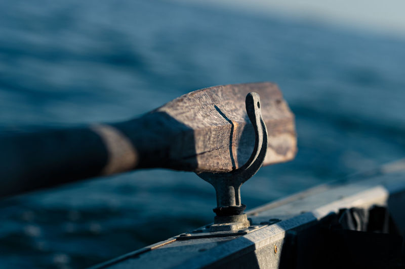 Wooden oar on a boat at sea with blurred background