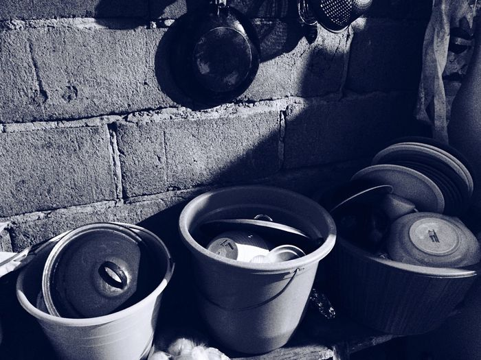 Close up of pots against brick wall