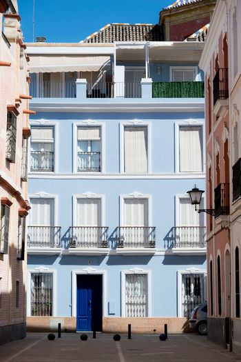 EyeEmNewHere Apartment Architecture Balcony Blue Building Building Exterior Built Structure City City Life Day House In A Row Nature No People Outdoors Residential District Row House Sky Sunlight Window