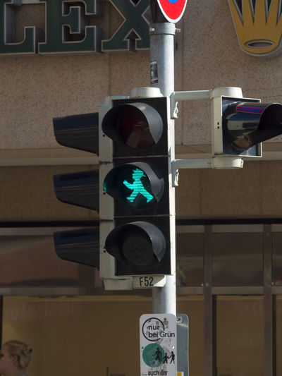 Road Signal Sign Green Light Communication Stoplight Road Sign Guidance Light No People Safety Architecture Representation Human Representation City Illuminated Built Structure Road Symbol Outdoors Day