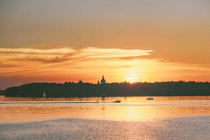 Boats City Skyline Water Fun Beauty In Nature Boats Cloud - Sky Idyllic Nature Nautical Vessel No People Non-urban Scene Orange Color Outdoors Scenics - Nature Sea Silhouette Sky Sunset Tranquil Scene Tranquility Transportation Tree Water Waterfront