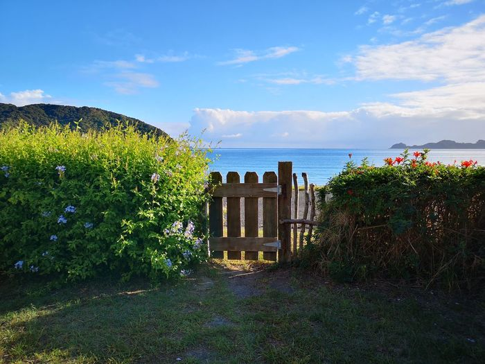 Gate Delapidated Rustic Water Flower Sea Tree Beach Summer Blue Front Or Back Yard Sky Horizon Over Water Tranquility Tranquil Scene Idyllic Ocean Coast The Mobile Photographer - 2019 EyeEm Awards