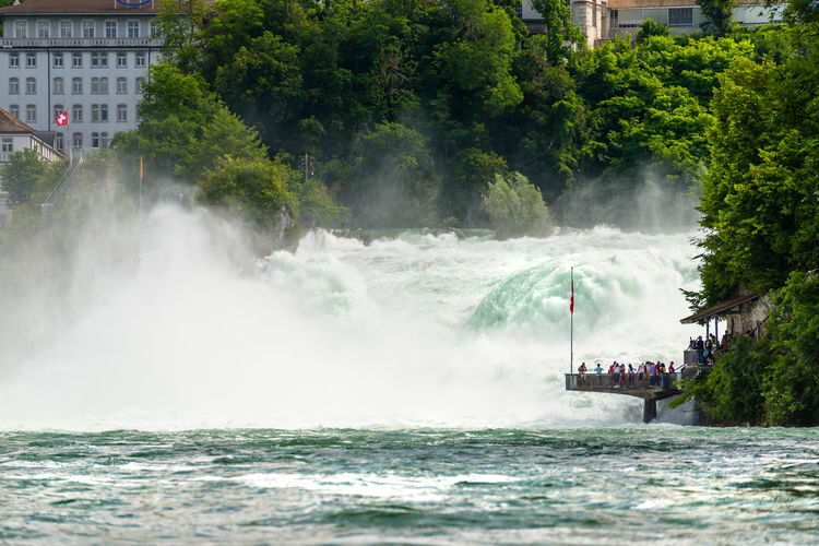 Waterfall on the river rhine in the city neuhausen am rheinfall in switzerland. tourists standing
