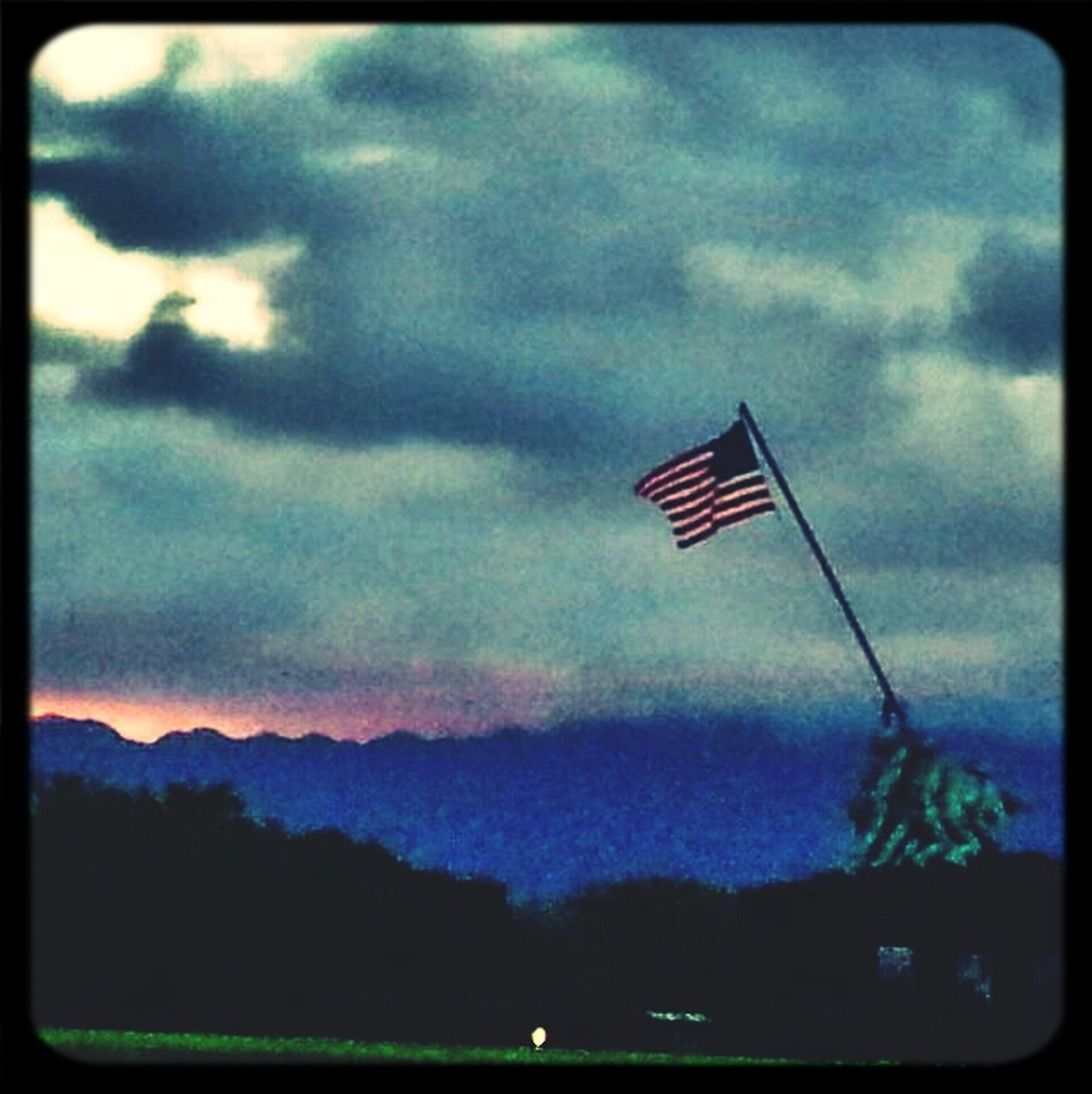 flag, sky, transfer print, identity, patriotism, national flag, low angle view, american flag, cloud - sky, auto post production filter, wind, cloud, red, cloudy, pole, nature, outdoors, no people, day, culture